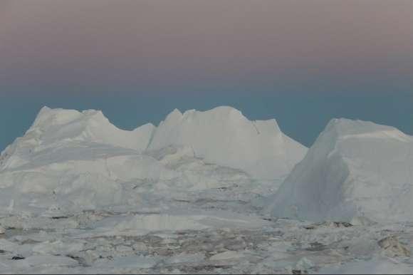 Sermermiut Icebergs in Ilulissat in Greenland under the midnight sun