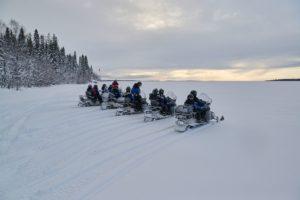 snowmobile adventure on frozen sea in Lulea