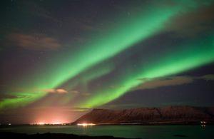 Aurora lights above the sea at Reykjavik in Iceland