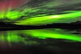 Aurora display above Lake Tornetrask Abisko Sweden