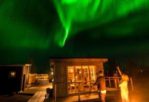 The Aurora above the arctic gourmet Cabins in Kiruna Sweden