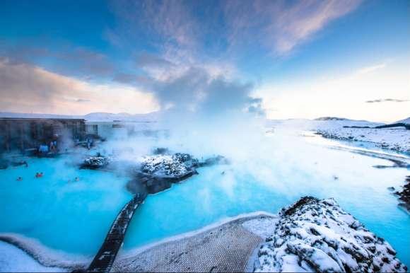 Couple enjoying the Blue Lagoon, Iceland