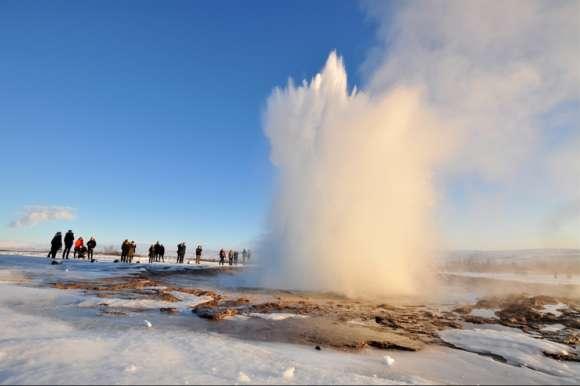 Erupting Strokkur geyser , Iceland