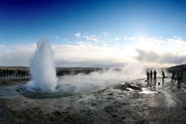 People watching a Strokkur geyser Iceland