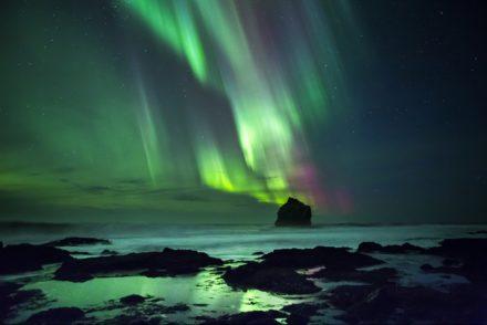 Aurora Borealis over black beaches in Vik on SuperJeep tour in Iceland