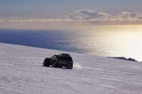 SuperJeep up the Eyjafjallajokull volcano at sunrise, Iceland