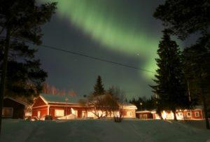 Northern Lights show above Pine Bay Lodge