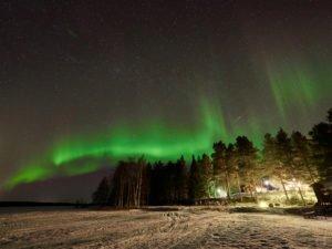 Stars and lights above Pine Bay Lodge