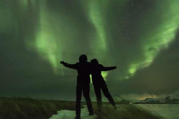 Couple enjoying the Northern Lights