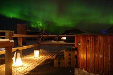 Enjoy a hot tub under the Northern Lights at Mattarahkka Lodge, Sweden