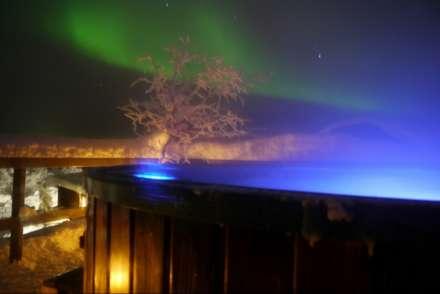 Northern Lights above the hot tub at Mattarahkka, Sweden