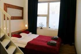 Sleeping area of a room at Mattarahkka Lodge, Sweden