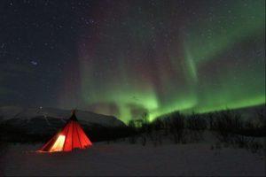 Northern Lights over tepee in Abisko, Sweden