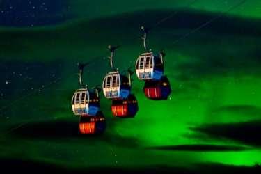Suspended Gondolas in Norway beneath the Northern Lights