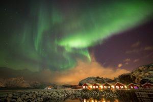Northern Lights over cabins Lofoten