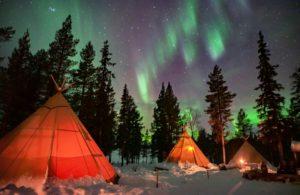 Dancing Northern lights over yurts