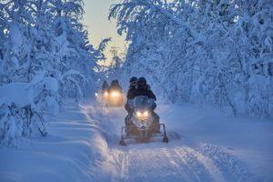 snowmbiles in forest Kiruna Sweden