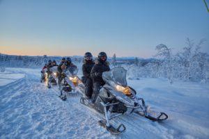 snowmobile safari in arctic wilderness swedish lapland