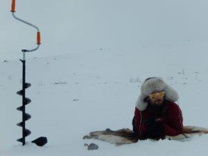 Andreas Mikko ice fishing near Abisko Sweden
