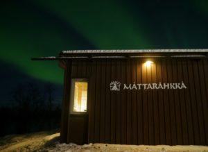 mattarahkka Lodge Kiruna Sweden with Aurora over lodge