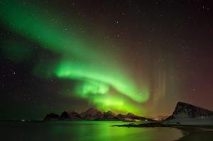 northern lights over norwegian coast near Lofoten