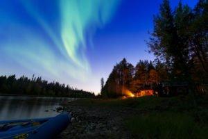 Northern Lights at dusk Torne River Sweden