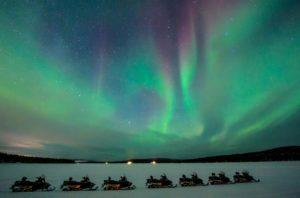 snowmobile safari under the aurora at ICEHOTEL Sweden