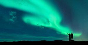 Couple beneath Northern Lights