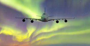 Airplane in aurora