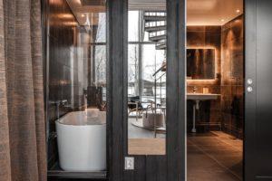 En suite bathroom with bath tub at the arctic bath in sweden