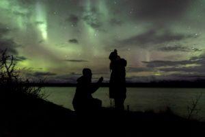 couple under the auroras in Abisko Sweden